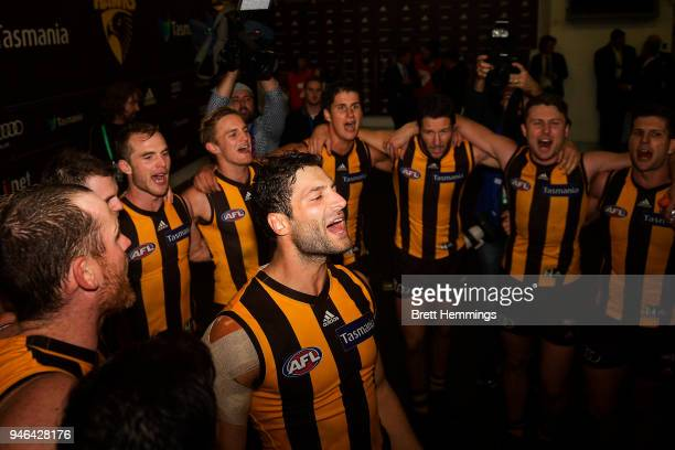 David Mirra of the Hawks celebrates victory with team mates during the round four AFL match between the Hawthorn Hawks and the Melbourne Demons at...