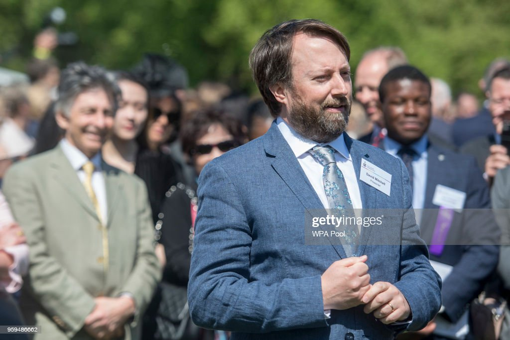 David Mitchell talks to young award winners at a Gold Award ceremony for the Duke of Edinburgh's Award in the gardens at Buckingham Palace on May 17, 2018 in London, England.