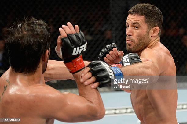 David Mitchell throws a punch at Yan Cabral in their welterweight bout during the UFC Fight Night event at the Ginasio Jose Correa on October 9, 2013...