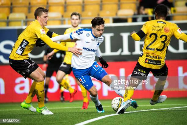 David Moberg Karlsson of IFK Norrkoping battles for the ball with Joakim Nilsson of IF Elfsborg and Alex Dyer of IF Elfsborg during the Allsvenskan...
