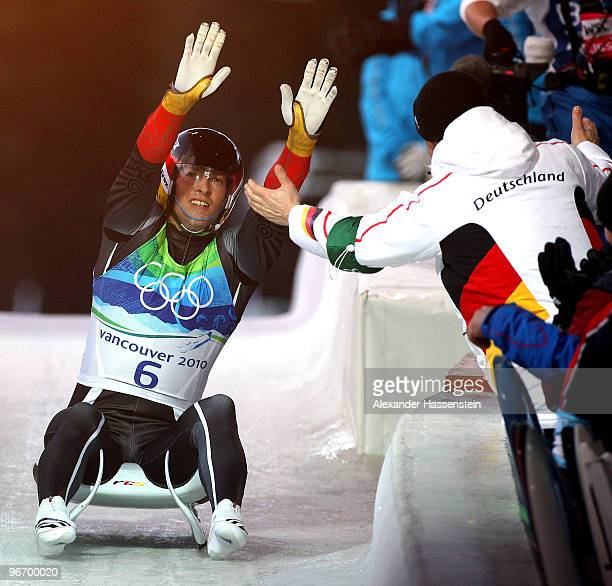 David Moeller of Germany celebrates winning the silver medal after finishing the final run of the men's luge singles final on day 3 of the 2010...