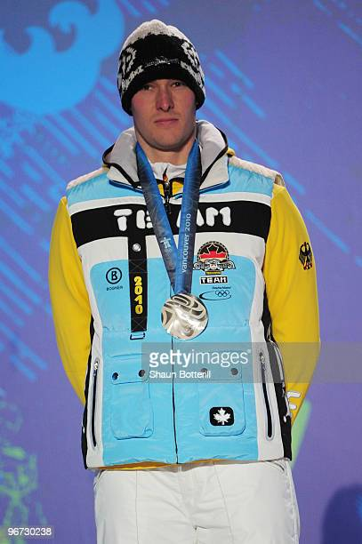 David Moeller of Germany celebrates winning the silver medal during the medal ceremony for the men�s luge singles at Whistler Medal Plaza on day 4 of...