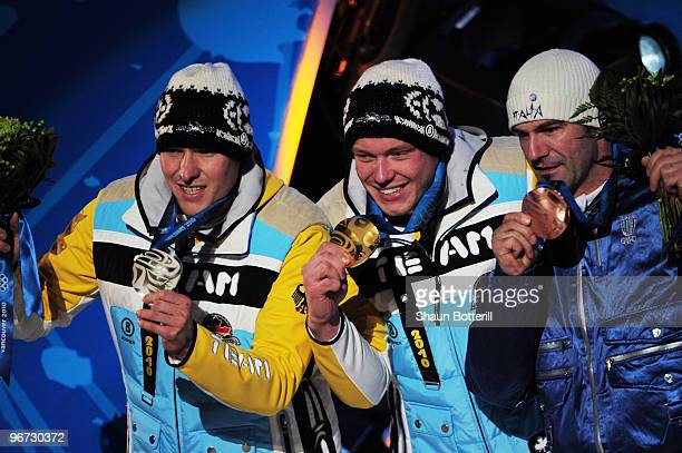 David Moeller of Germany celebrates winning the silver medal Felix Loch of Germany poses with the gold and Armin Zoeggeler of Italy poses with the...