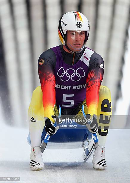 David Moeller of Germany completes a men's luge run during a training session ahead of the Sochi 2014 Winter Olympics at the Sanki Sliding Center on...