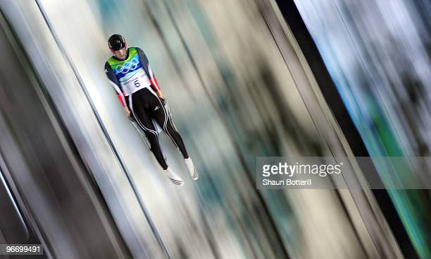 David Moeller of Germany in action on his way to winning the silver medal during the final run of the men's luge singles final on day 3 of the 2010...