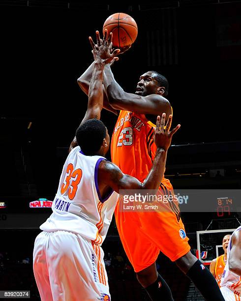 David Monds of the Albuquerque Thunderbirds takes a shot over Cartier Martin of the Iowa Energy on December 04 2008 at Wells Fargo Arena in Des...