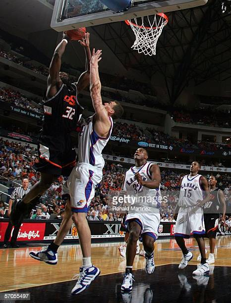 David Monds of the Oklahoma State Cowboys goes up for a shot against Sasha Kaun of the Kansas Jayhawks during the quarterfinals round of the Phillips...