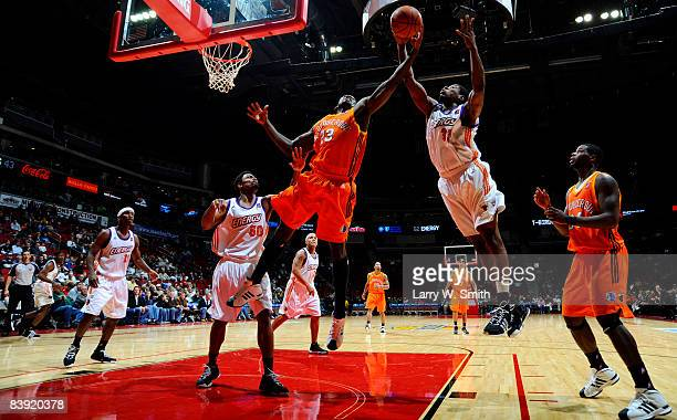 David Monds the Albuquerque Thunderbirds goes for a rebound against Cartier Martin of the Iowa Energy on December 04 2008 at Wells Fargo Arena in Des...