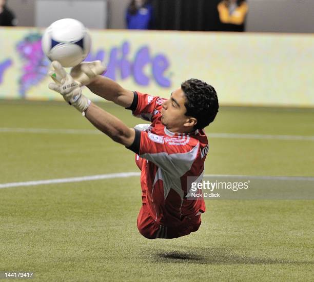 David Monsalve of FC Edmonton tips the ball to make it bounce off the post of his goal during their game against Vancouver Whitecaps at BC Place May...