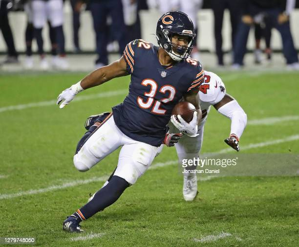 David Montgomery of the Chicago Bears breaks a run past Devin White of the Tampa Bay Buccaneers at Soldier Field on October 08, 2020 in Chicago,...