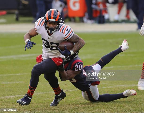 David Montgomery of the Chicago Bears breaks away from Justin Reid of the Houston Texans at Soldier Field on December 13, 2020 in Chicago, Illinois....
