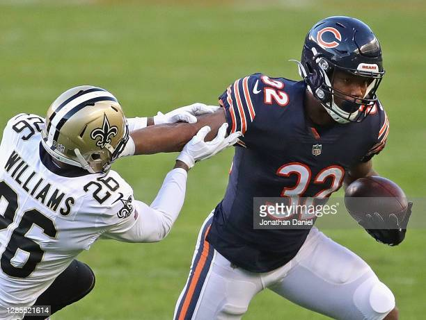 David Montgomery of the Chicago Bears breaks away from P.J. Williams of the New Orleans Saints at Soldier Field on November 01, 2020 in Chicago,...