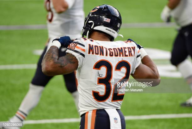 David Montgomery of the Chicago Bears celebrates after scoring a third quarter touchdown against the Minnesota Vikings at U.S. Bank Stadium on...