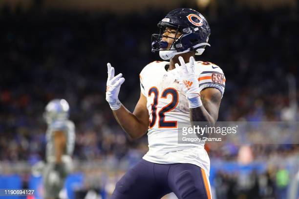 David Montgomery of the Chicago Bears celebrates his fourth quarter touchdown against the Detroit Lions at Ford Field on November 28 2019 in Detroit...