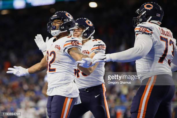 David Montgomery of the Chicago Bears celebrates his fourth quarter touchdown with teammates while playing the Detroit Lions at Ford Field on...