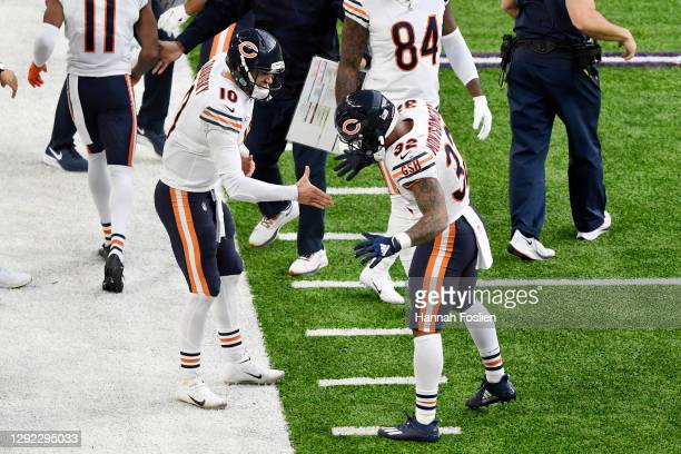 David Montgomery of the Chicago Bears celebrates with Mitchell Trubisky after scoring a third quarter touchdown against the Minnesota Vikings at U.S....