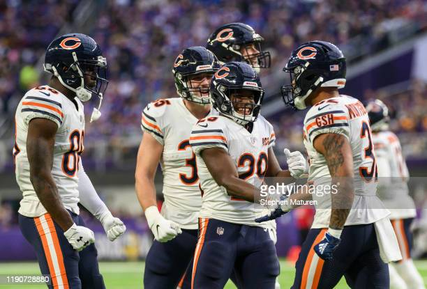 David Montgomery of the Chicago Bears celebrates with teammates after scoring a touchdown in the third quarter of the game against the Minnesota...