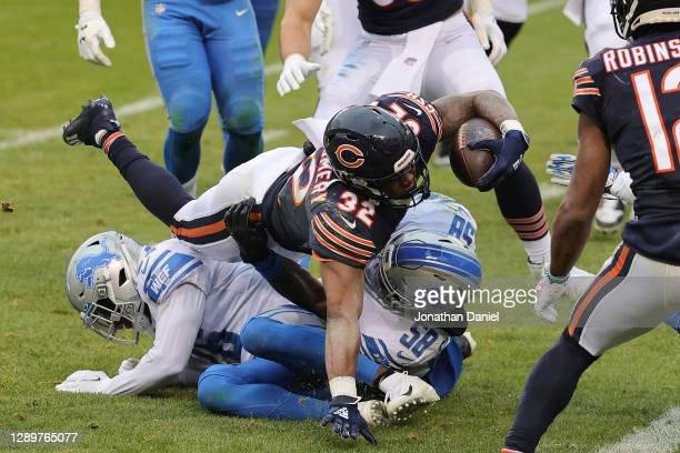David Montgomery of the Chicago Bears dives across the goal-line for a four-yard rushing touchdown against the Detroit Lions during the first half at...