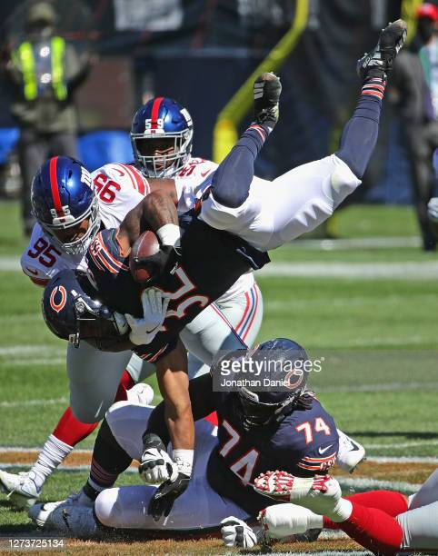 David Montgomery of the Chicago Bears flips in the air as he's hit by B.J. Hill of the New York Giants at Soldier Field on September 20, 2020 in...