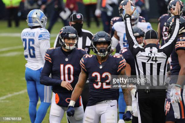 David Montgomery of the Chicago Bears is congratulated by Mitchell Trubisky after scoring a four-yard rushing touchdown against the Detroit Lions...