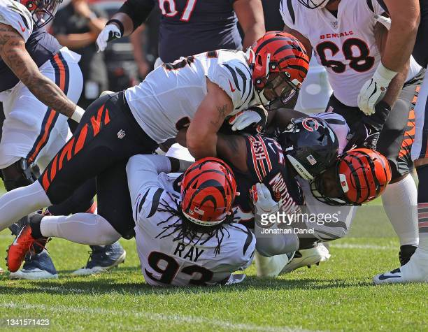 David Montgomery of the Chicago Bears is dropped by Logan Wilson, Wyatt Ray and B.J. Hill of the Cincinnati Bengals at Soldier Field on September 19,...