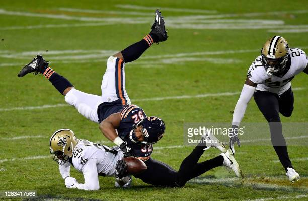David Montgomery of the Chicago Bears is tackled by P.J. Williams of the New Orleans Saints in the fourth quarter at Soldier Field on November 01,...