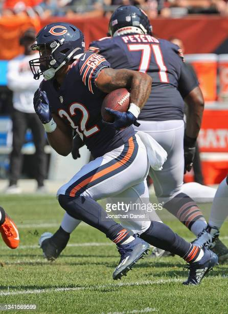 David Montgomery of the Chicago Bears runs against the Cincinnati Bengals at Soldier Field on September 19, 2021 in Chicago, Illinois. The Bears...