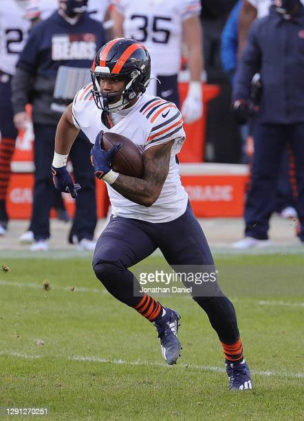 David Montgomery of the Chicago Bears runs against the Houston Texans at Soldier Field on December 13, 2020 in Chicago, Illinois. The Bears defeated...