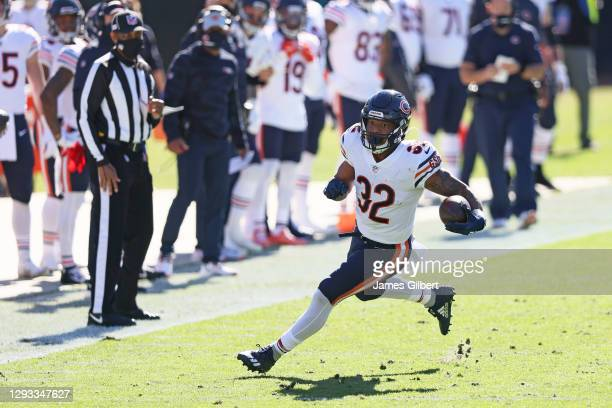 David Montgomery of the Chicago Bears runs for yardage during the first quarter against the Jacksonville Jaguars at TIAA Bank Field on December 27,...