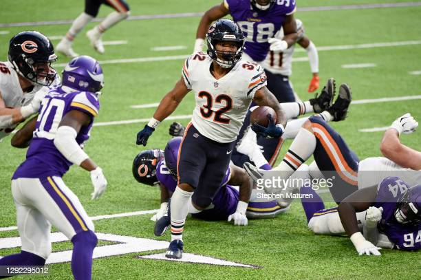 David Montgomery of the Chicago Bears runs on his way to scoring a third quarter touchdown against the Minnesota Vikings at U.S. Bank Stadium on...