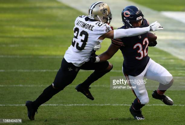 David Montgomery of the Chicago Bears runs the ball against Marshon Lattimore of the New Orleans Saints in the first quarter at Soldier Field on...