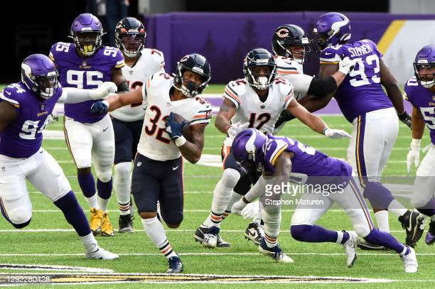 David Montgomery of the Chicago Bears runs with the ball during the first quarter against the Minnesota Vikings at U.S. Bank Stadium on December 20,...