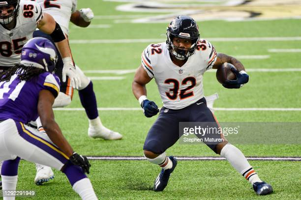 David Montgomery of the Chicago Bears runs with the ball during the first half against the Minnesota Vikings at U.S. Bank Stadium on December 20,...