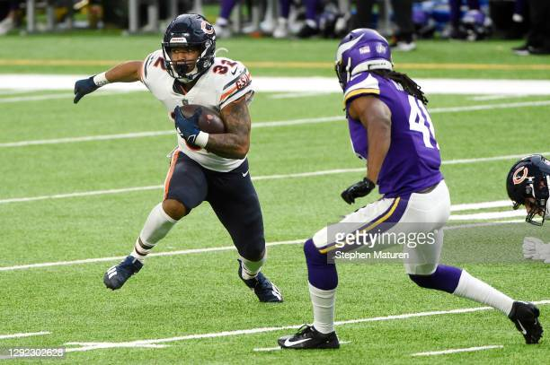 David Montgomery of the Chicago Bears runs with the ball during the second half against the Minnesota Vikings at U.S. Bank Stadium on December 20,...