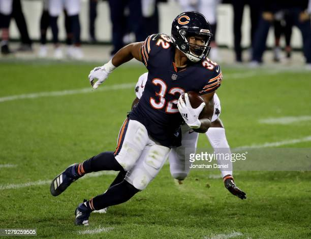 David Montgomery of the Chicago Bears runs with the ball in the fourth quarter against the Tampa Bay Buccaneers at Soldier Field on October 08, 2020...