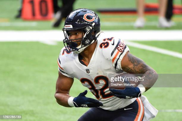 David Montgomery of the Chicago Bears rushes for a second quarter touchdown against the Minnesota Vikings at U.S. Bank Stadium on December 20, 2020...