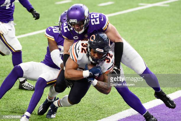 David Montgomery of the Chicago Bears rushes for a third quarter touchdown as Jeff Gladney and Harrison Smith of the Minnesota Vikings are unable to...