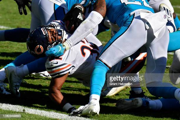 David Montgomery of the Chicago Bears scores a touchdown past Jeremy Chinn of the Carolina Panthers in the third quarter at Bank of America Stadium...