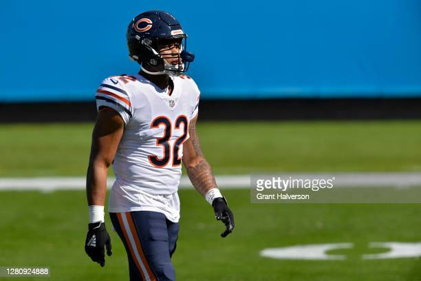 David Montgomery of the Chicago Bears walks across the field before the game against the Carolina Panthers at Bank of America Stadium on October 18,...