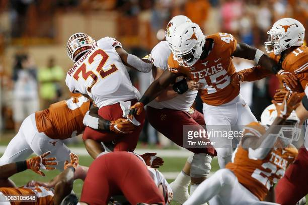 David Montgomery of the Iowa State Cyclones is stopped at the line of scrimmage by Gary Johnson of the Texas Longhorns and Anthony Wheeler in the...
