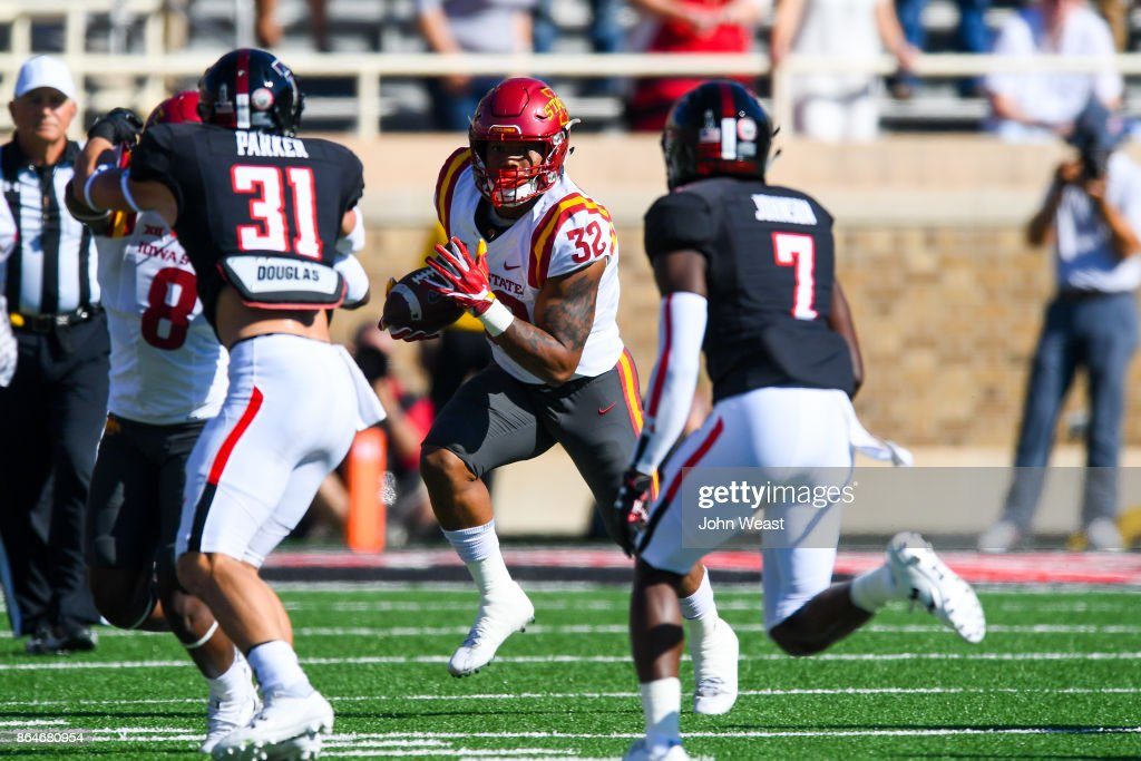 David Montgomery #32 of the Iowa State Cyclones looks for running room against the Texas Tech Red Raiders during the game on October 21, 2017 at Jones AT&T Stadium in Lubbock, Texas.