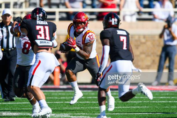 David Montgomery of the Iowa State Cyclones looks for running room against the Texas Tech Red Raiders during the game on October 21 2017 at Jones ATT...