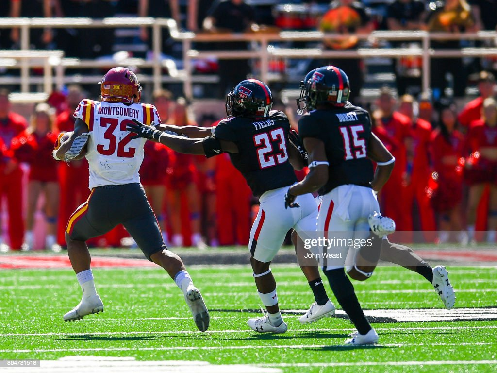David Montgomery #32 of the Iowa State Cyclones outruns the Texas Tech Red Raiders defense during the game between the Texas Tech Red Raiders and the Iowa State Cyclones on October 21, 2017 at Jones AT&T Stadium in Lubbock, Texas. Iowa State defeated Texas Tech 31-13.