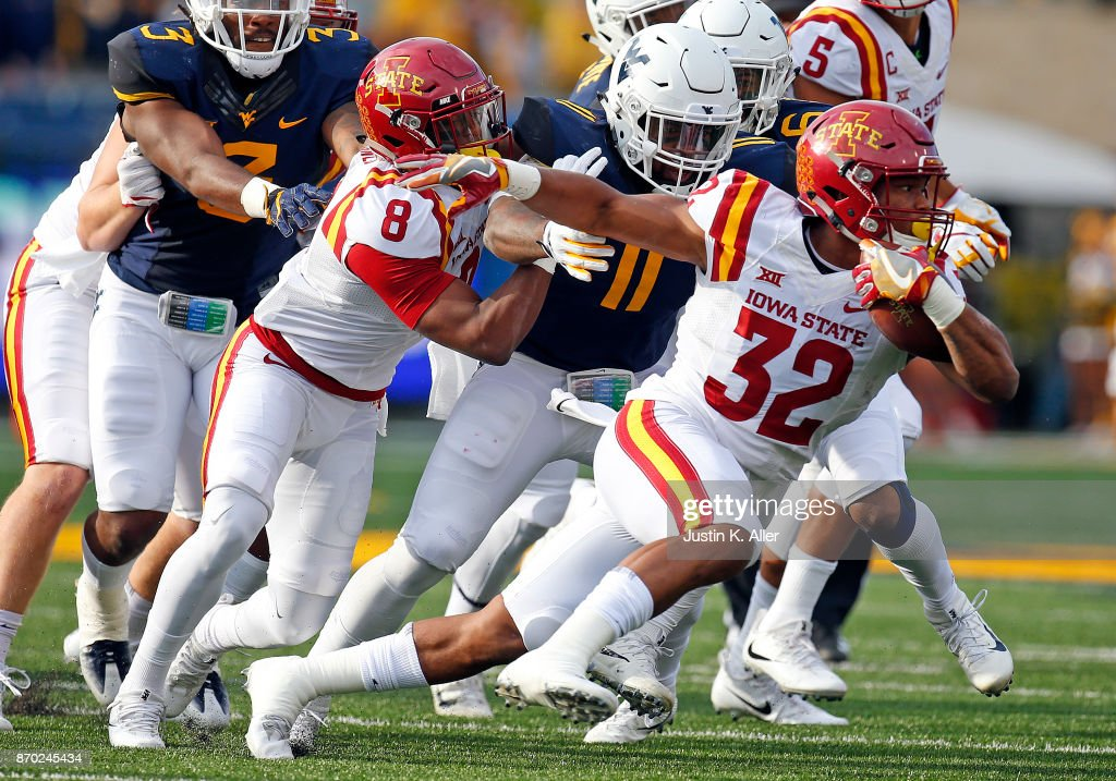 David Montgomery #32 of the Iowa State Cyclones rushes against the West Virginia Mountaineers at Mountaineer Field on November 04, 2017 in Morgantown, West Virginia.