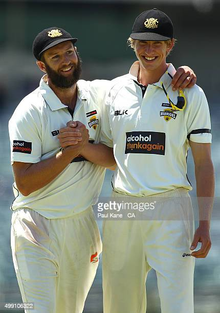 David Moody of Western Australia congratulates Andrew Tye at the conclusion of the first innings during day three of the Sheffield Shield match...