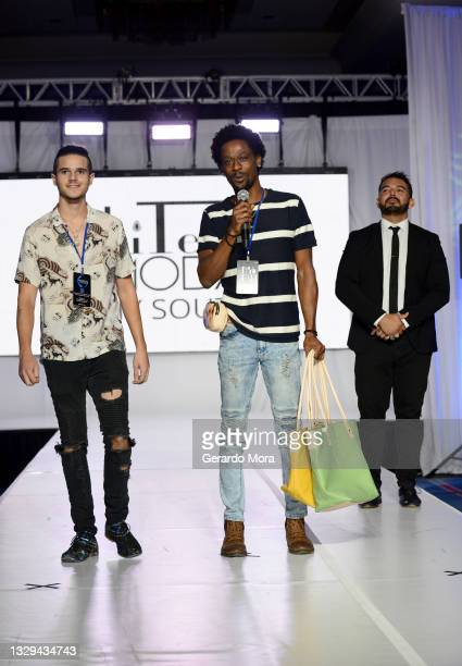 David Moody speaks on the runway of Moody and Co Leather during Orlando Swim Week Powered By hiTechMODA on July 18, 2021 in Orlando, Florida.