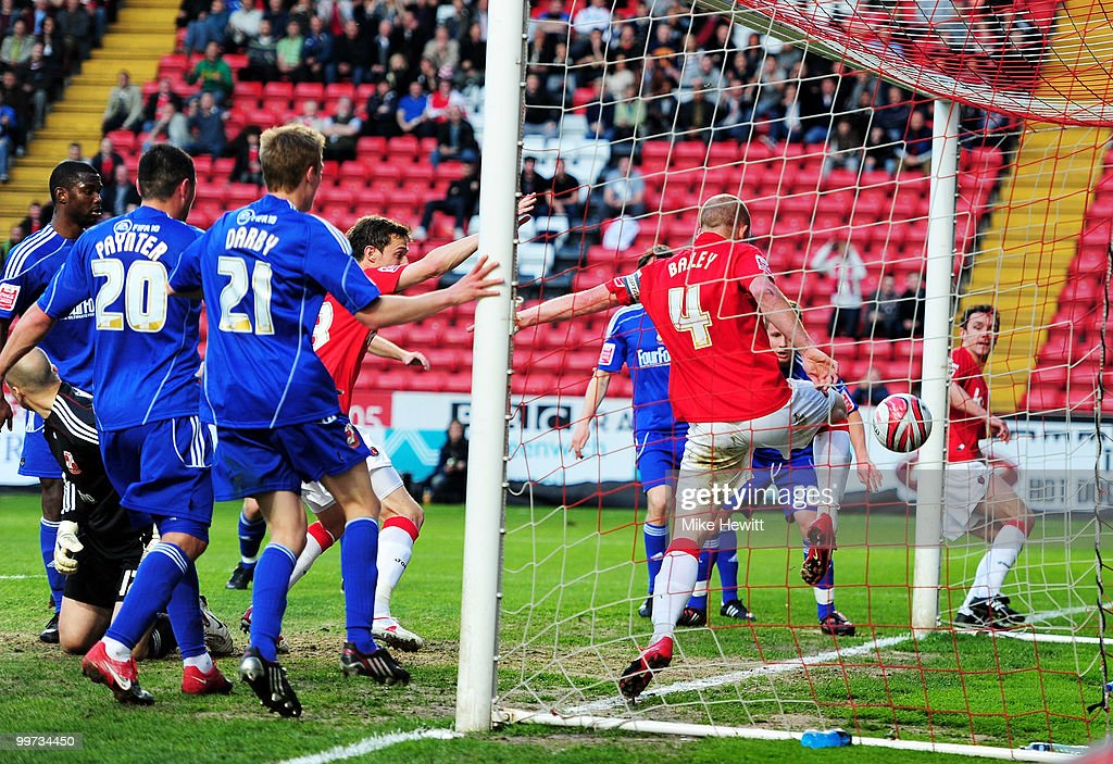 David Mooney of Charlton (partly obscured by no.21) scores during the Coca-Cola League One Playoff Semi Final 2nd Leg between Charlton Athletic and Swindon Town at The Valley on May 17, 2010 in London, England.