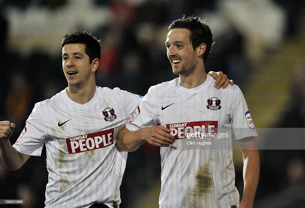 David Mooney (right) of Leyton Orient celebrates with team-mate Lloyd James after he scores the first goal of the game for his side during the FA Cup with Budweiser Third Round match between Hull City and Leyton Orient at the KC Stadium on January 5, 2013 in Hull, England