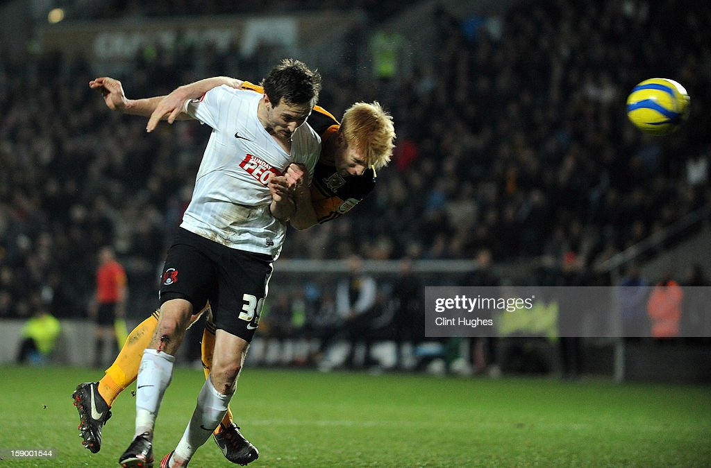 David Mooney (left) of Leyton Orient scores the first goal of the game for his side during the FA Cup with Budweiser Third Round match between Hull City and Leyton Orient at the KC Stadium on January 5, 2013 in Hull, England