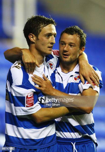 David Mooney of Reading celebrates with Matthew Mills after scoring the fifth goal for Reading during the Carling Cup first round match between...